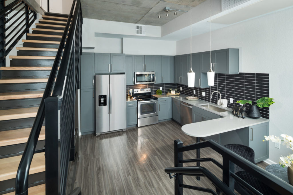 stainless steel appliances in your Alexan 20th Street Station gourmet kitchen - Find What You Crave