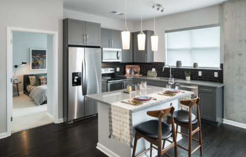 Gourmet kitchen at Alexan 20th Street Station - Festive Denver Luxury Apartment
