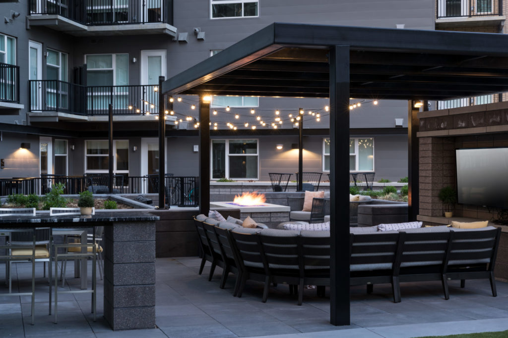 Fire features and comfy seating at Alexan 20th Street Station - Weekends Are Back in a Big Way