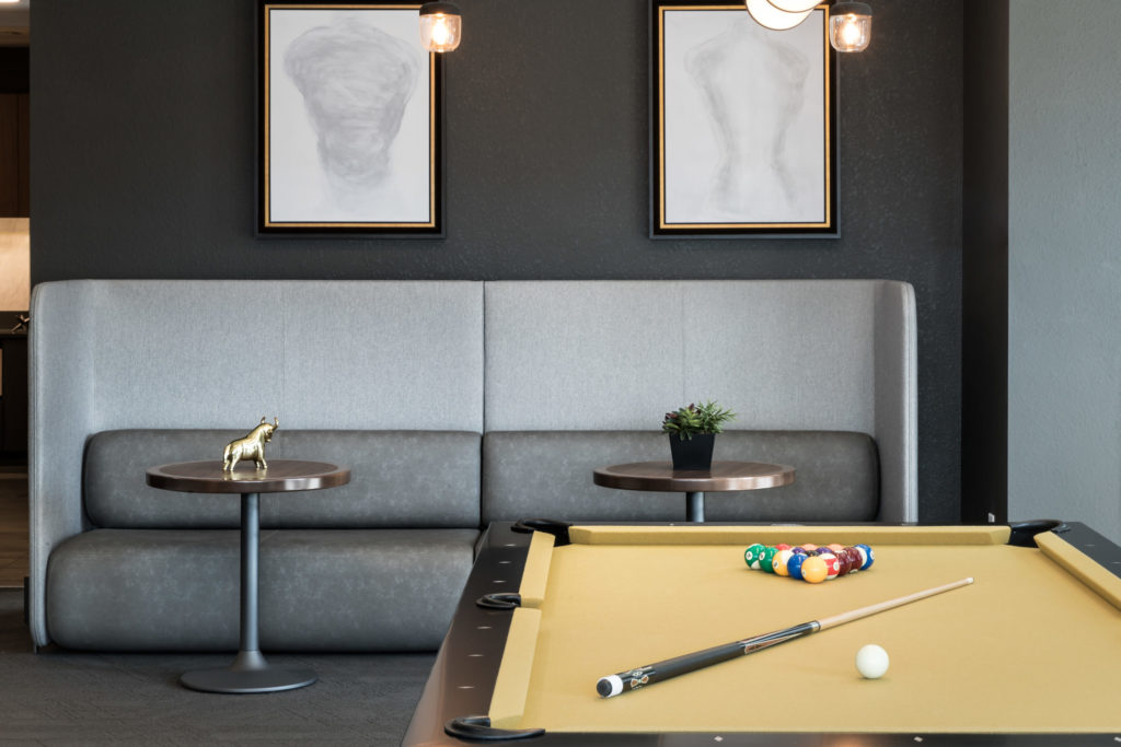 Billiards table and comfy seating in the clubroom - Fun Around Every Corner